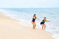 Fitness Exercises. Healthy Couple Squatting, Exercising On Beach Stock Photos