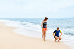Fitness Exercises. Healthy Couple Squatting, Exercising On Beach royalty free stock photos