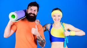 Fitness exercises. Workout and fitness. Girl and guy live healthy life. Fitness coach. Exercising together is fun. Healthy lifestyle concept. Man and woman stock photo