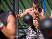 Fitness and Exercising Concept: Boy with Naked Torso Having Workout with Boxing Speed Ball Outdoor at Gym.  Stock Photography