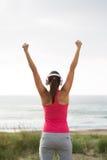 Fitness female athlete celebrating exercising achievement Stock Photo