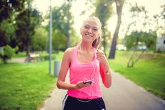 Fitness female athlete enjoying a running workout in park Stock Photos