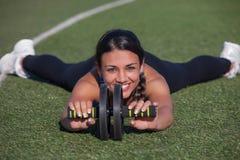 Fitness female athlete exercising Royalty Free Stock Image