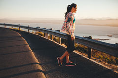 Fitness female athlete standing outdoors looking at a view Stock Image