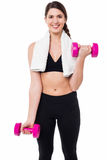 Fitness female instructor lifting dumbbells Royalty Free Stock Images