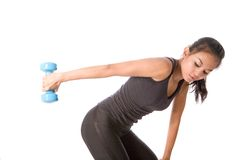 Fitness female lifting dumbell. Young fitness female lifting dumbell in arm to strengthen arm muscle Stock Photo