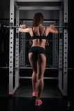Fitness-Female Lifting Weights-Rear View Stock Photos