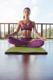 Fitness female meditating in health club Royalty Free Stock Photos