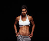 Fitness female model posing on black background Royalty Free Stock Photography
