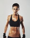 Fitness female posing confidently stock photo