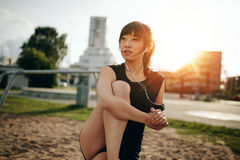 Fitness female relaxing after workout. Royalty Free Stock Photography