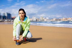 Fitness female runner at city beach Stock Photos
