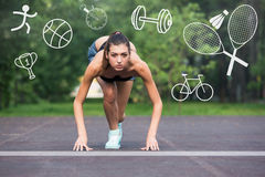 Fitness female runner. In ready start line pose outdoors in summer sprint challenge Royalty Free Stock Photos