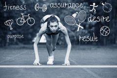 Fitness female runner. In ready start line pose outdoors in summer sprint challenge Stock Images