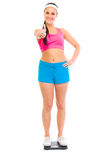 Fitness female standing on weight scale Stock Photos