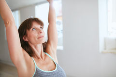 Fitness female in warrior pose Royalty Free Stock Images
