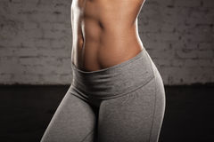 Fitness female woman with muscular body, do her workout, abs, abdominals Royalty Free Stock Photography