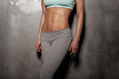 Fitness female woman with muscular body, do her workout, abs Stock Images