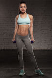 Fitness female woman with muscular body Stock Photo