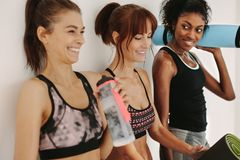 Fitness females in gym relaxing after workout royalty free stock images