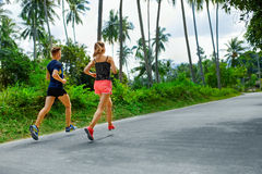 Fitness. Fit Athletic Couple Running. Runners Jogging. Sports. H. Fitness. Fit Athletic Couple Running On Road, Training For Marathon. Sporty Runners Jogging stock photo