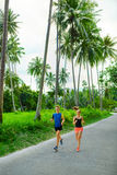Fitness. Fit Athletic Couple Running. Runners Jogging. Sports. H. Fitness. Fit Athletic Couple Running On Road, Training For Marathon. Sporty Runners Jogging stock photography