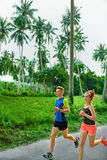 Fitness. Fit Athletic Couple Running. Runners Jogging. Sports. H. Fitness. Fit Athletic Couple Running On Road, Training For Marathon. Sporty Runners Jogging royalty free stock images