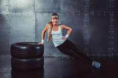Fitness fit woman sport model doing core, push-ups Royalty Free Stock Photography