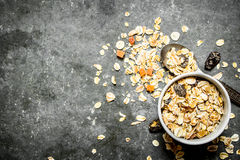 Fitness food. Cereals with dried fruit in the Cup. On the stone table Royalty Free Stock Photos