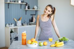 Fitness Food. Healthy Eating Woman On Diet Drinking Fresh Detox Juice, Smoothie For Breakfast. Closeup Of Beautiful Smiling Girl W stock photos