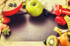 Fitness frame with dumbbells and fresh fruits. Healthy lifestyle Royalty Free Stock Photo