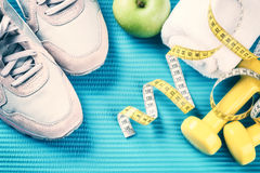 Fitness frame with dumbbells, sneakers and green apple . Healthy Royalty Free Stock Image