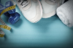 Fitness frame with dumbbells, sport shoes and towel. Healthy lif Stock Images