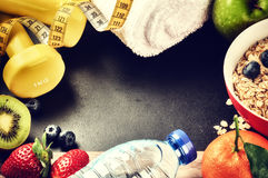 Fitness frame with dumbbells, water bottle and fresh fruits. Hea Royalty Free Stock Photo
