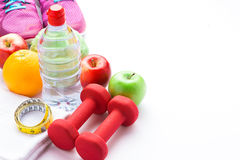 Fitness frame with dumbbells, water bottle and fresh fruits. Hea Stock Photo