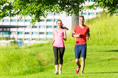 Fitness Friends running together Royalty Free Stock Image