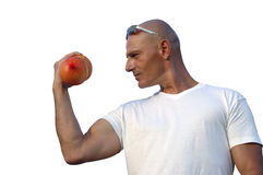 Fitness with fruits. Man holding grapefruit for fitness Royalty Free Stock Image