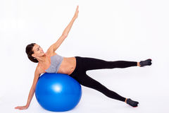 Fitness is fun!. Portrait of an attractive young woman using a fitness ball for an upper body workout ovet white isolated background Stock Photos