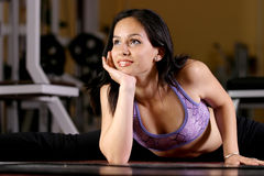 Fitness girl. A fitness girl working out in the gym Royalty Free Stock Images
