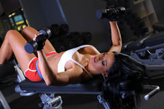 Fitness girl. Working out in gymnasium Stock Image