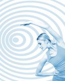Fitness girl. Beautiful girl training fitness on abstract background (toned in blue Stock Photos