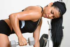 Fitness Girl. Beautiful  girl working out in a gym Royalty Free Stock Photo