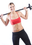 Fitness Girl. Cute girl lifting weights with a white background Royalty Free Stock Photos