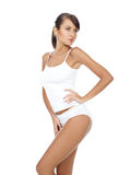 Fitness girl. Young beautiful woman in white fitness clothing stock photo