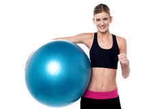Fitness girl with aerobic ball  showing thumbs sign Stock Images