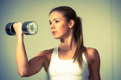 Fitness girl - attractive young woman working out with dumbbells Royalty Free Stock Photo