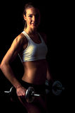 Fitness girl - attractive young woman working out with dumbbells Stock Image