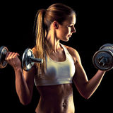 Fitness girl - attractive young woman working out with dumbbells Royalty Free Stock Image