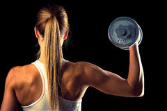 Fitness girl - attractive young woman working out with dumbbells Royalty Free Stock Images
