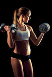 Fitness girl - attractive young woman working out with dumbbells Stock Photo